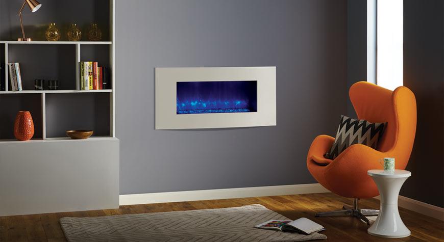 Le Radiance 85R Verve XS encastrable électrique de Gazco en ivoire avec effet de combustibles en cailloux en verre noir.