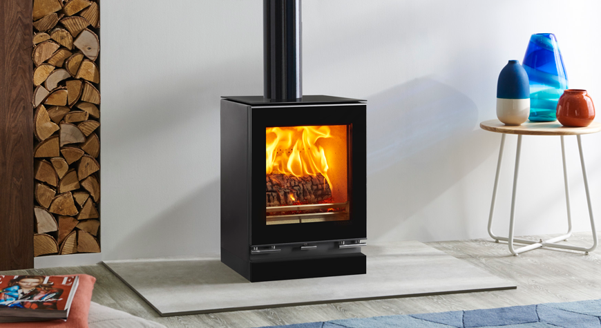 Vision-small-woodburning-with-optional-glass-top-plate-plinth-and-gloss-black-flue-pipe-mainimage3